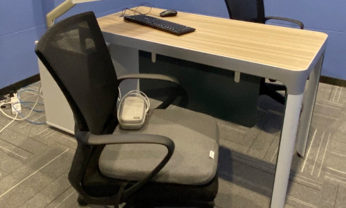 """A """"smart cushion"""" built into office chair contains sensors that monitor the heart rate and tally the minutes spent at office workstations."""